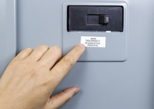 Finger pointing to main circuit breaker